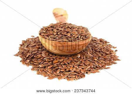 Flax Seeds In Wooden Spoon Isolated On White Background.  Also Known As Linseed, Flaxseed And Common