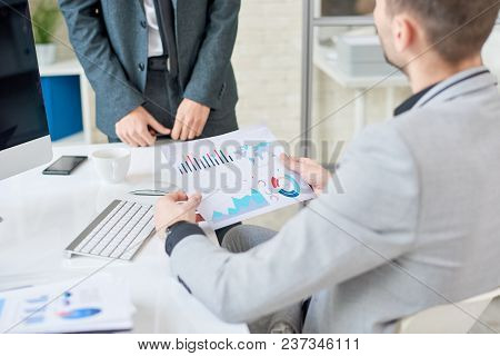 Close-up Shot Of Unrecognizable Managers Analyzing Results Of Accomplished Work With Help Of Statist