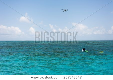 Flying Drone On Sky Follow Diver Snorkeling On The Sea