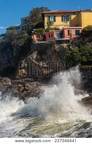 Waves Splashing On The Cliff In The Small Village Of Tellaro, In The Gulf Of La Spezia, Liguria, Ita