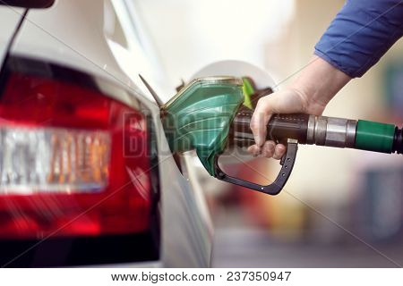 Refueling the car at a gas station fuel pump
