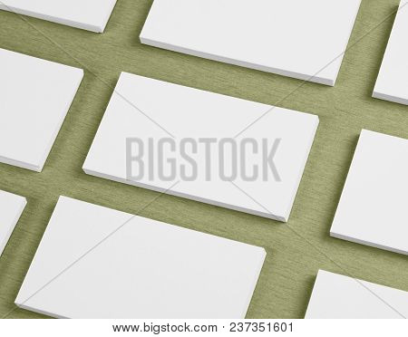 Mockup Of Horizontal Business Cards Stacks Arranged In Rows At Green Textured Background