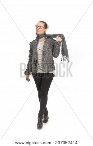A Girl In Demi-season Clothes With A Full-length On A White Background.