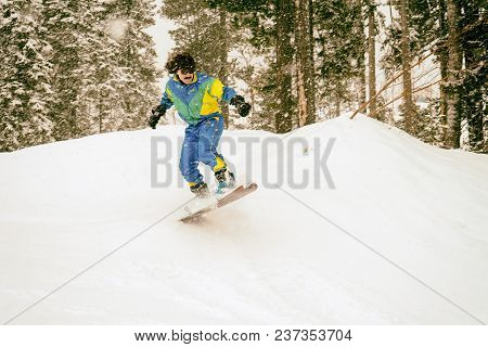 Vintage Photo Of Young Man Snowboarder Jumping In The Mountains, Retro Style 1980 Concept. Toned.