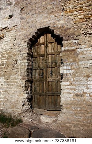The Secret Passage In A Wall Of Izborsk Fortress Is Closed By Heavy Wooden Doors.