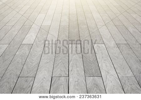 The Surface With Elongated Rectangular Stone Tiles Of Gray Color Goes Into Perspective
