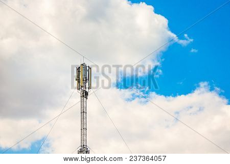 An Aerial Of Cellular Communication On  Background Of White Clouds,  Transfer Of Information Over A