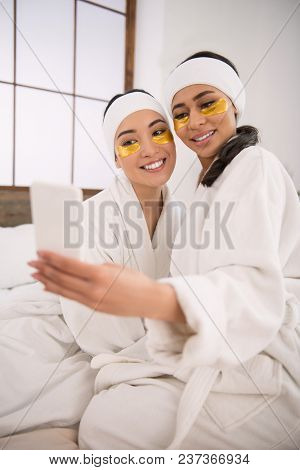 Our Beauty. Positive Lesbian Couple Taking Photos While Being In The Spa Salon