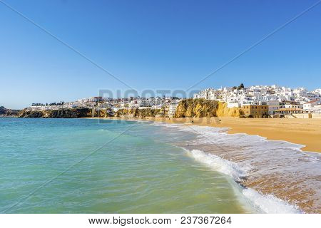 Sandy Beach And Cliffs In White City Of Albufeira, Algarve, Portugal