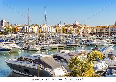 Marina Full Of Luxurious Yachts In Touristic Vilamoura, Algarve, Portugal