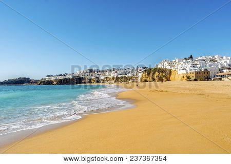 Wide, Sandy Beach In White City Of Albufeira, Algarve, Portugal