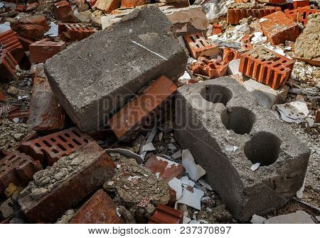 Construction Garbage Background. Pieces Of Broken Bricks, Concrete Blocks. Abandoned Building. Grung