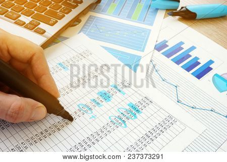 Business Audit. Auditor Checking Documents With Financial Figures.