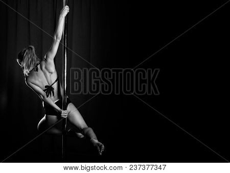 Young Sexy Woman Exercise Pole Dance On Dark Background, Beautiful Girl In Club, Sporty Elegant Woma
