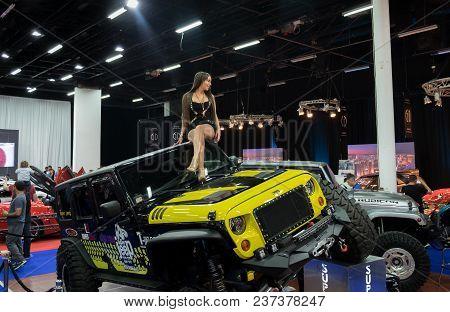 Tel-aviv, Israel - April 12, 2017: Undefined Beautiful Promotion Girl Sit On Jeep Car At Tel-aviv Mo
