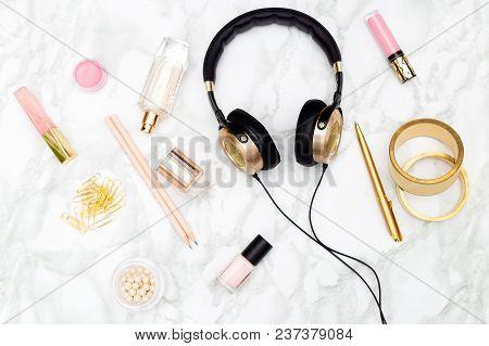 Feminine Desktop. Beauty And Headphones On A Marble Background.