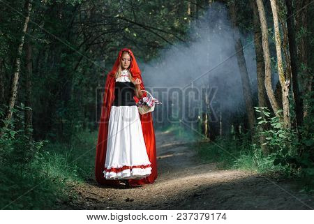 Girl in red raincoat. Cosplay Fairy Tale Little Red Riding Hood poster
