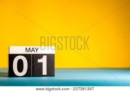 May 1st. Day 1 Of May Month, Calendar On Yellow Background. Spring Time, International Labor Day.