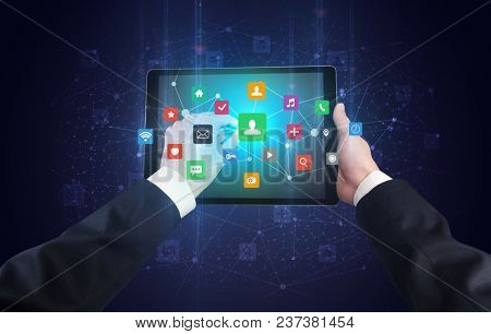 Hand using tablet with colorful bounce application symbols and icons concept