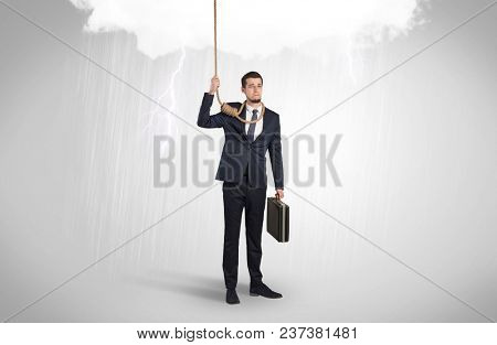 Young businessman trying to suicide with pointing hands concept