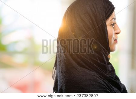 Young arab woman wearing hijab with crossed arms confident and happy with a big natural smile laughing