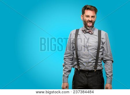Middle age man, with beard and bow tie feeling disgusted with tongue out