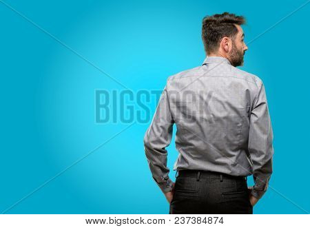 Middle age man, with beard and bow tie backside, rear view
