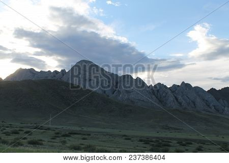 Wide Steppe With Yellow Grass Under A Blue Sky With White Clouds Sayan Mountains Siberia Russia. Bea