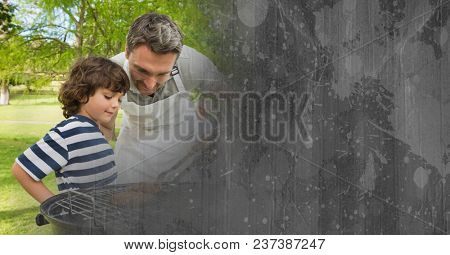 Father and son at bbq with grey cardboard transition