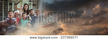 Family laughing on couch with evening sky transition