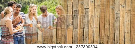 Millennials laughing and eating at bbq with wood panel transition
