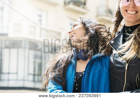 An Attractive Young Lesbian Couple On A Street