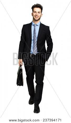 Young manager holding a suitcase isolated on white