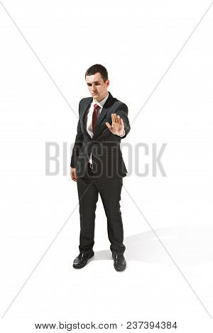 Above Front Portrait Of Businessman With Serious Face. Confident Professional With Piercing Look In