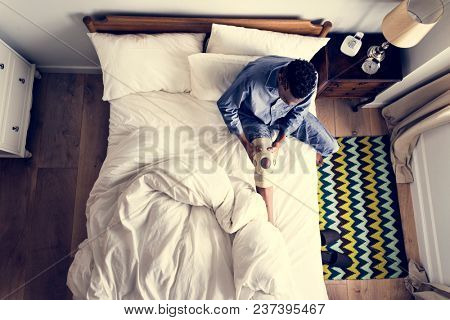 Injured man on the bed
