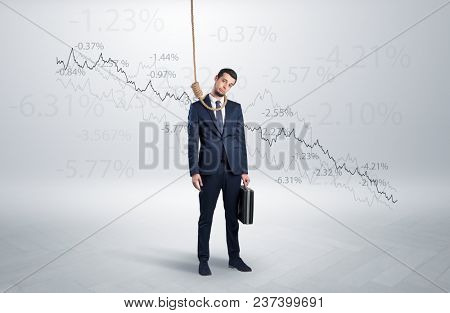 Desperate young businessman with decreasing bankruptcy concept