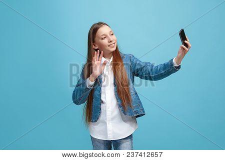 Happy Teen Girl Standing, Smiling Isolated On Trendy Pink Studio Background. Half-length Portrait. Y