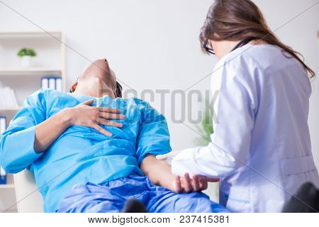 Scared patient man getting ready for flu shot