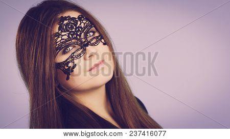Pretty Mysterious Woman Wearing Black Eye Lace Mask Having Long Brown Hair.