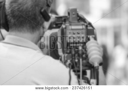 Blur - Professional Cameraman - Covering The Event With A Video - Black And White Tone