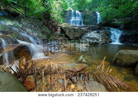 Borneo Rain Forest Waterfall, Idyllic Stream Flowing In The Lush Green Jungle Of Kubah National Park