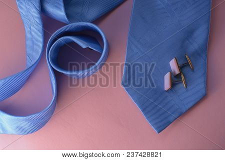 Blue Tie With Cuff On Pink Background
