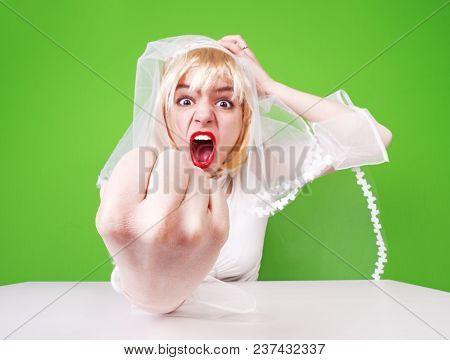 Angry Bride. Beautiful, Pretty, Furious Woman In Wedding Dress Girl, Bride, Lady Shows Her Hand With
