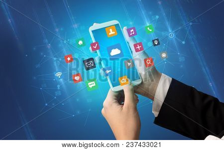 Female hand using smartphone with colorful application icons around