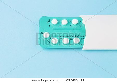 Pack Of Contraceptive Pills With Instructions. Blister In White Case On Blue Background