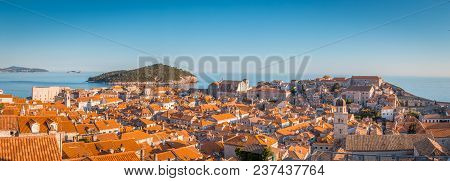 Panoramic View Of The Old Town Of Dubrovnik In Beautiful Golden Evening Light At Sunset With Blue Sk