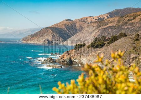 Scenic View Of The Rugged Coastline Of Big Sur With Santa Lucia Mountains And Big Creek Bridge Along