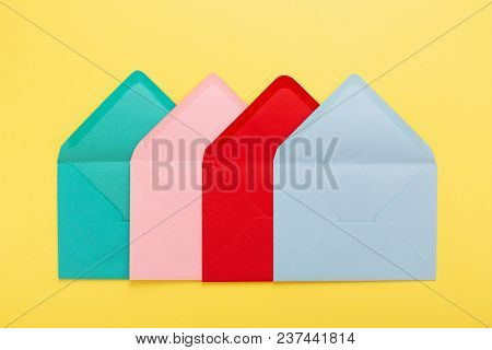 Abstract Background With Colorful Envelopes On Yellow Paper. Conceptual Card With Association.