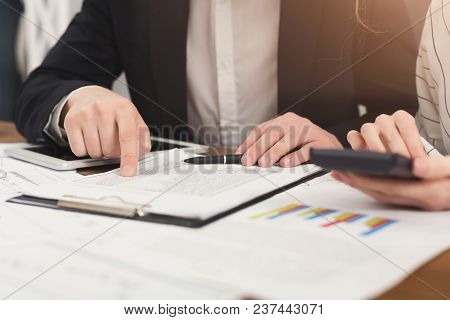 Closeup Of Business Colleagues Hands Working With Financial Documents And Counting Account On Calcul