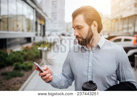 Busy Man Is In A Hurry, He Does Not Have Time, He Is Going To Talk On The Phone On The Go. Businessm